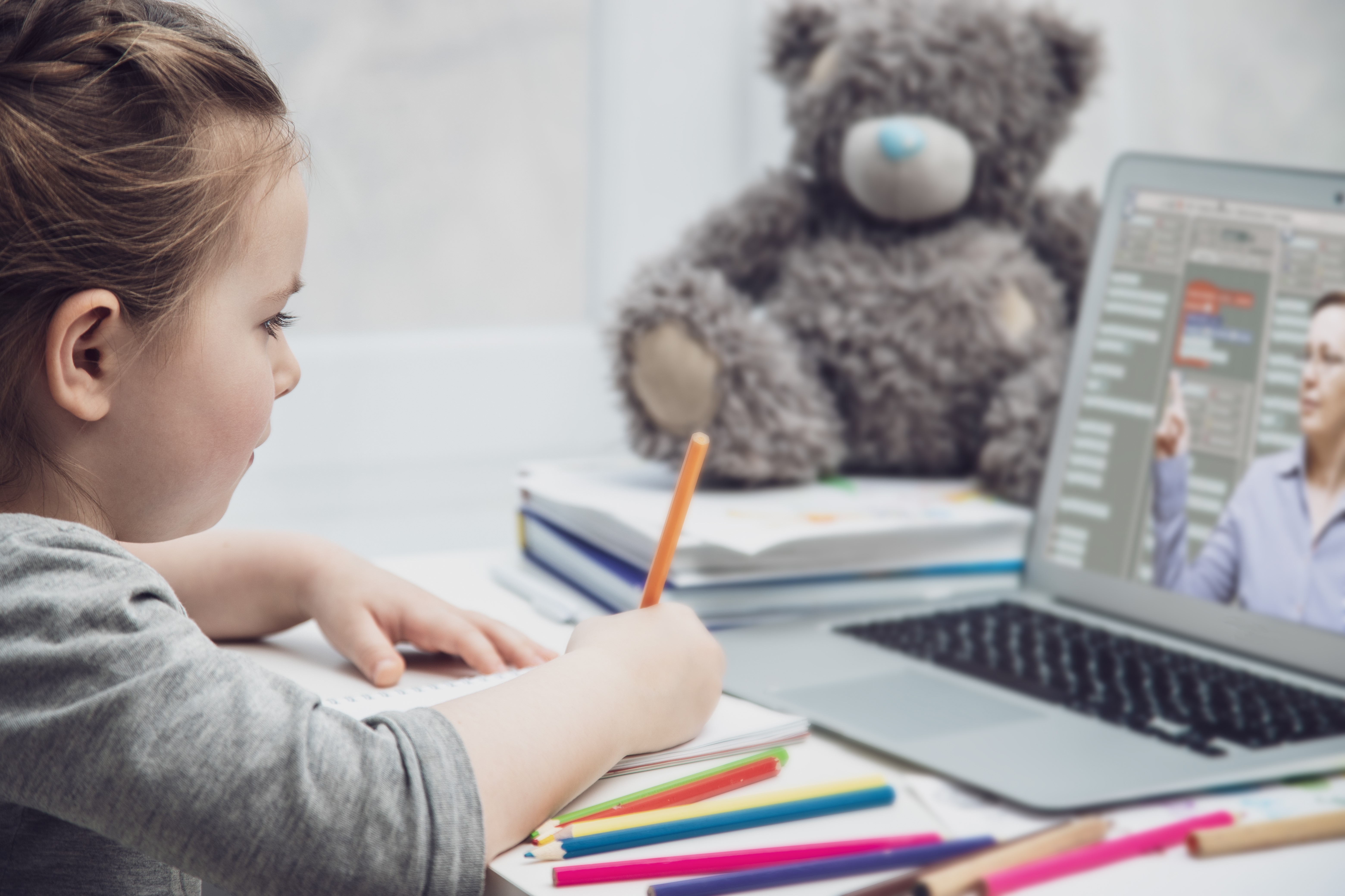 Child using laptop for e-learning